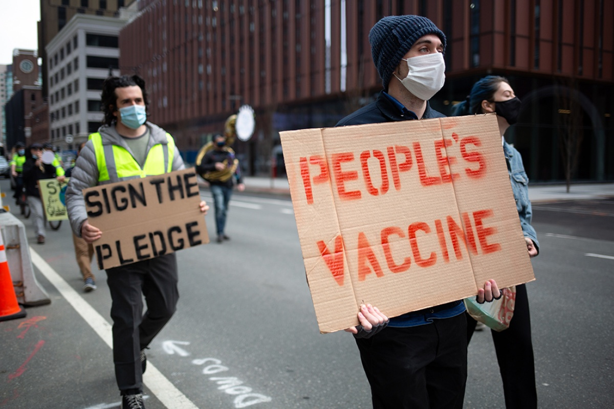 Supporters of a People's Vaccine for COVID-19 march through Cambridge, Massachusetts