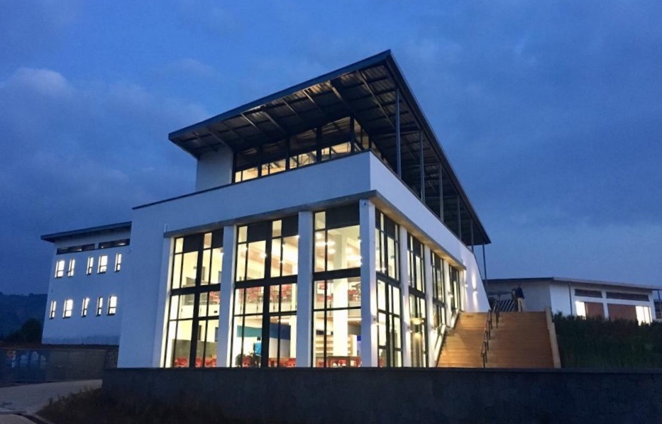 UGHE's administration building lights up twilight on campus in January 2019.