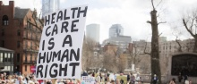 health care is a human right sign at State House rally in Boston