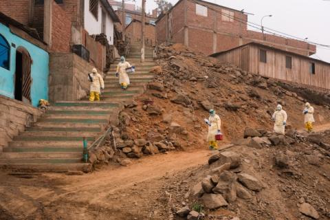 Socios En Salud staff visit homes and communities in Lima, Peru