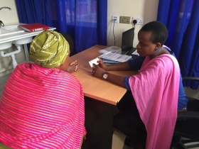 Alphonsine Imanishimwe, coordinator of the 2017 hepatitis C trial in Rwanda, counsels a new patient