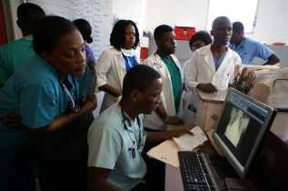 PIH partners with Zamni Lasante to offer 6 medical residency programs at University Hospital of Mirebalais—so far, 123 residents have graduated and 98% have opted to stay in Haiti, contributing to building a stronger health system.