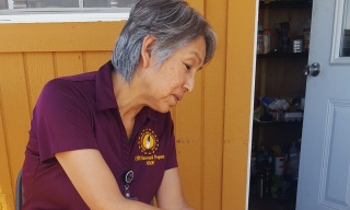 A side profile of Marlene Nez wearing a maroon shirt