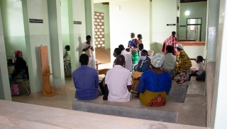 People chat in the waiting area of the new integrated care building in Neno, Malawi