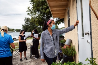community health worker visits homes in Immokalee, Florida, to educate on COVID-19