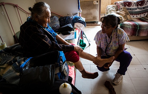 Nurse treating elderly woman in the Navajo Nation