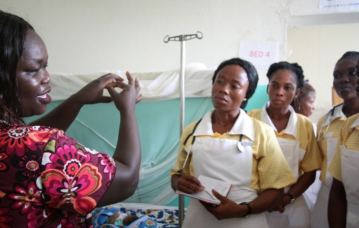 female doctor teaches nurse trainees in southeast Liberia