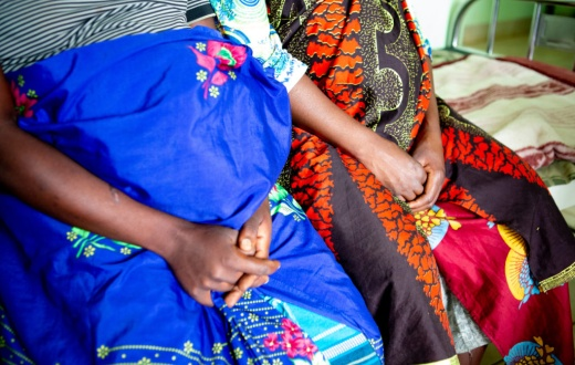 Two women rest at Neno District Hospital's maternal waiting home.