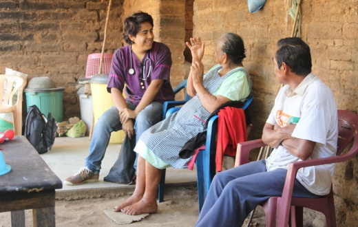 Each year, Partners In Health trains a new cohort of 10 first-year clinicians, who work in rural communities in Chiapas, Mexico. In this photo, a pasante speaks with patients in Chiapas.