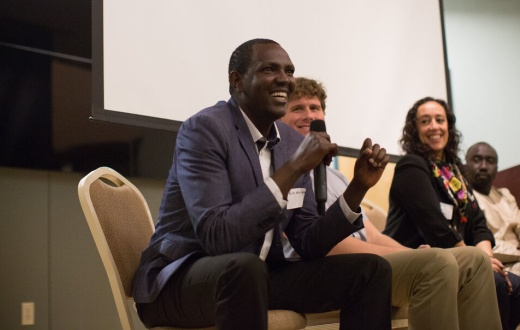 Dr. Melino Ndayizigiye speaks at a cross-site PIH event in 2017