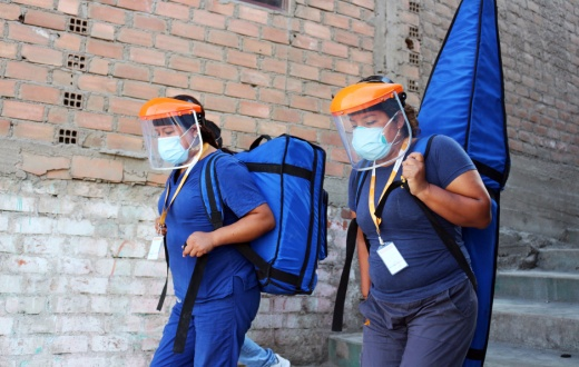 "Health care workers from Socios En Salud, as PIH is known in Peru, carry the ""Backpack TB"" machine."