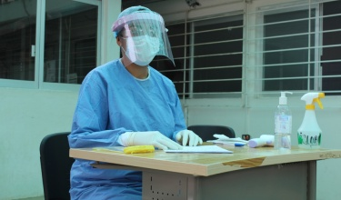 A nurse hired by CES wearing PPE in the triage area of the Basic Community Hospital Angel Albino Corzo in Jaltenango.