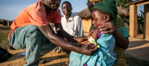 CHW Samuel Saidi checking for malnutrition in Kaingirira Village, Malawi