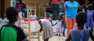 Rose Marie Renati teaches children in Fond Michel about handwashing