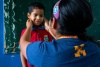 Nurse Nataly Cueva screens a student's health at an elementary school in Carabayllo, Peru.
